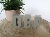 Betonnen letters doopsuiker