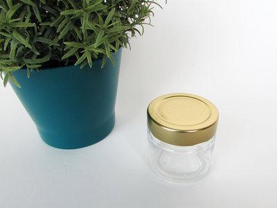 Glazen potje met gouden deksel